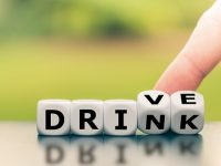 "Drink or drive? Hand turns dice and changes the word ""drink"" to ""drive"", or vice versa."